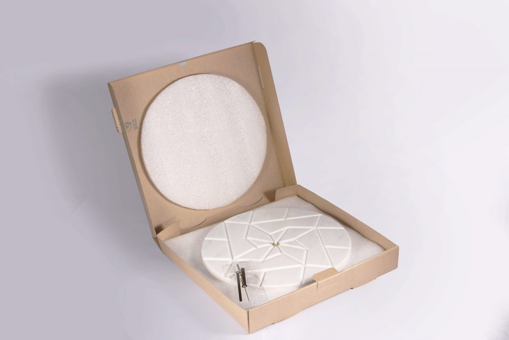 a white marble wall clock